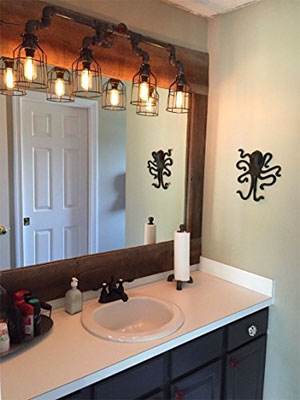Industrial Vanity Lamp Made of Steel Pipe and Cage Light Shades Above Mirror in Bathroom